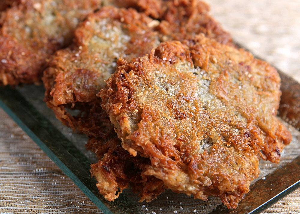 Latkes, also commonly called potato pancakes, are prepared by frying grated potato and onions.
