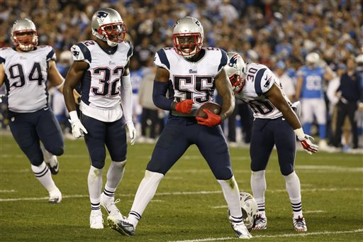 Patriots outside linebacker Akeem Ayers (55) celebrates his interception against the San Diego Chargers on Sunday. The Associated Press