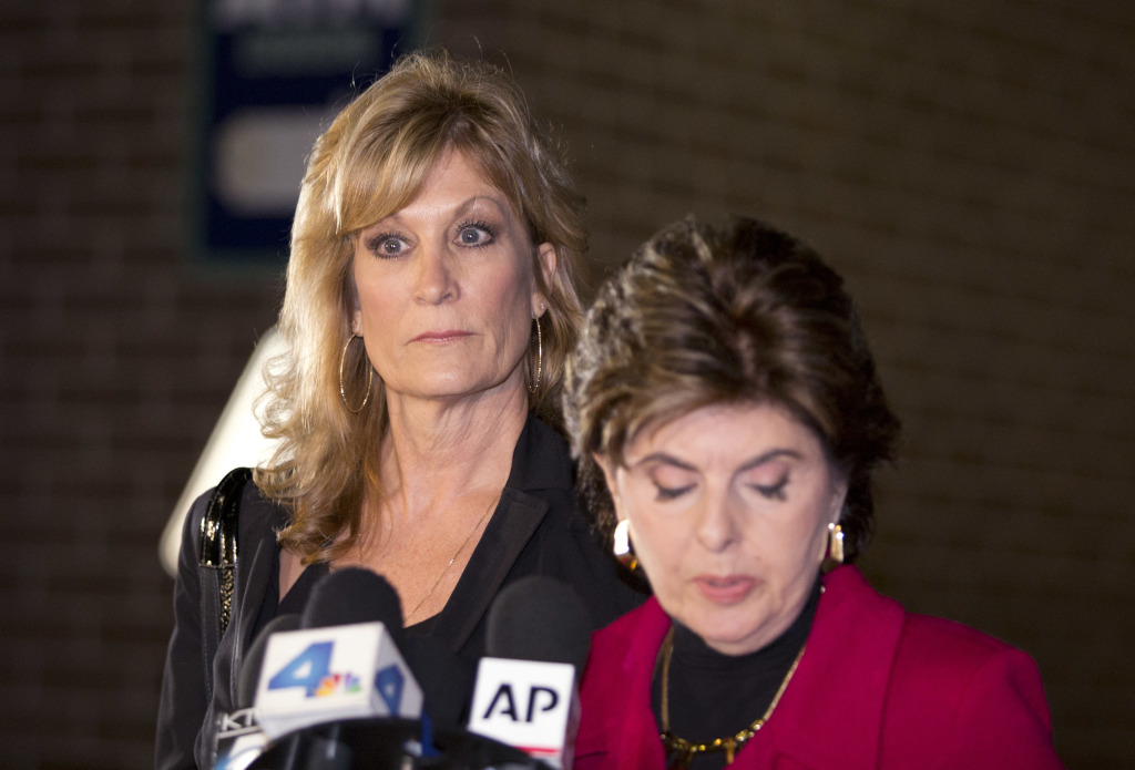 Judy Huth, left, appears at a press conference with attorney Gloria Allred outside the Los Angeles Police Department's Wilshire Division station on Friday. Allred announced that they have met with Los Angeles police detectives to open a formal investigation into claims Bill Cosby molested Huth when she was 15 years old in a bedroom of the Playboy Mansion.