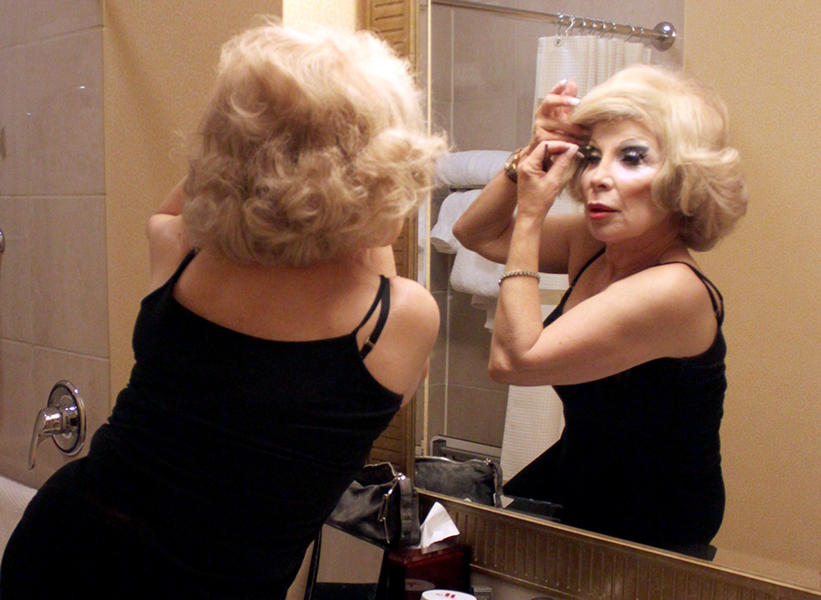 Linda Axelrod, a celebrity impersonator who also inhabits Marilyn Monroe and Charo, transforms into Joan Rivers before a charity event in November. Washington Post photo by Jessica Contrera