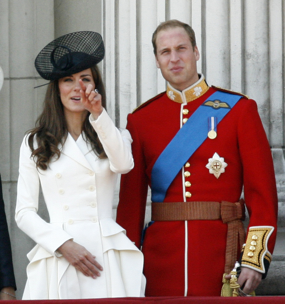 Britain's Prince William, Duke of Cambridge, right and his wife, Catherine, Duchess of Cambridge, on the balcony of Buckingham Palace in June 2011. The royal couple are due to arrive in New York City on Sunday for the first trip either has made to the United States' largest city.