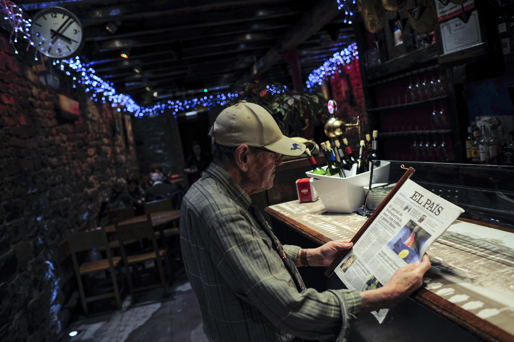 A man reads the Spanish newspaper ''El Pais'' in Pamplona on Thursday. Google announced it will block reports from Spanish publishers from more than 70 Google News editions. The Associated Press