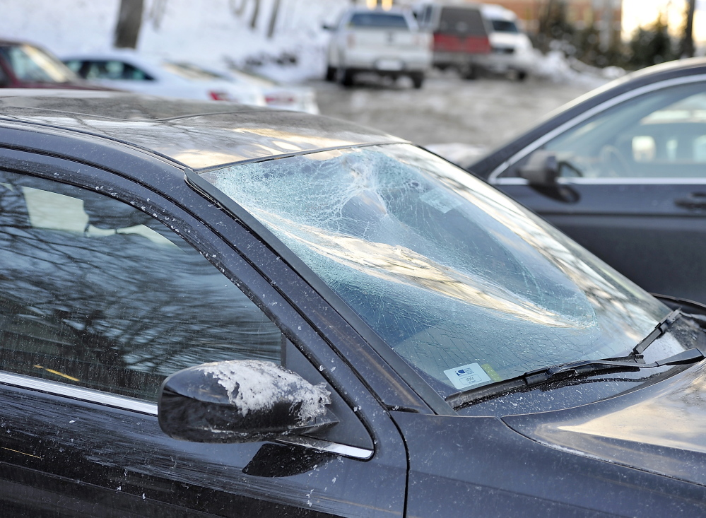 A chunk of ice caved in this car windshield