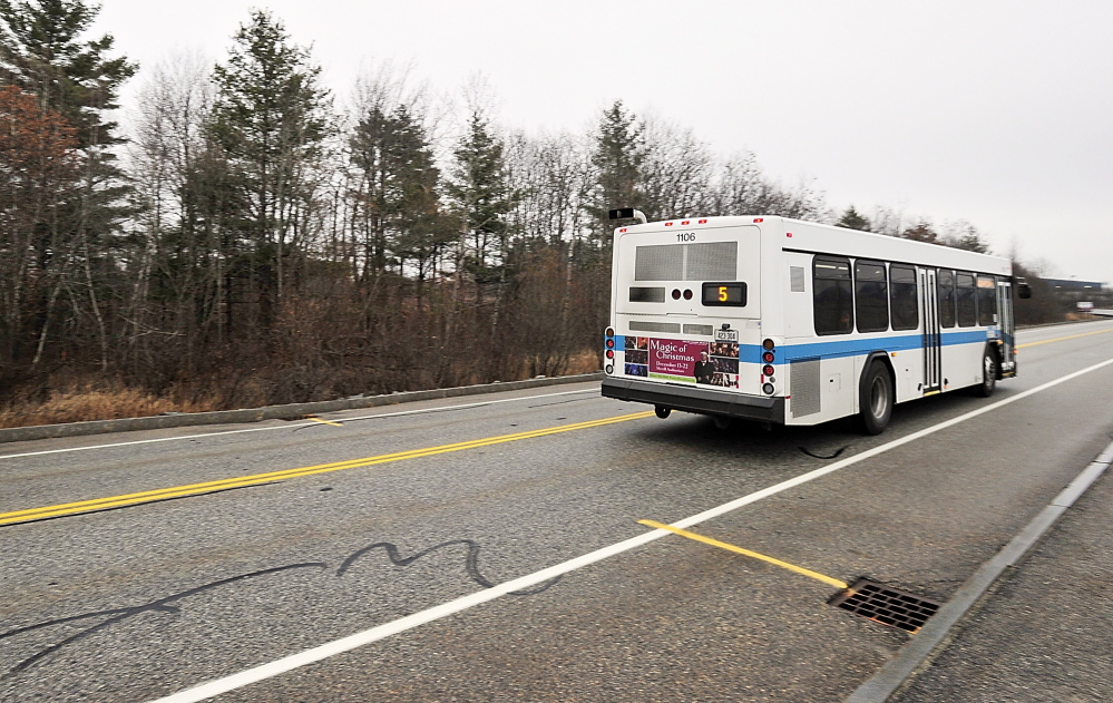 A Metro bus passes the entrance to the new DHHS building property near the Portland International Jetport in 2013. Changes to the bus route will cut the travel time from Portland in half, and open other opportunities for people to get around without a car. Gordon Chibroski/Staff Photographer
