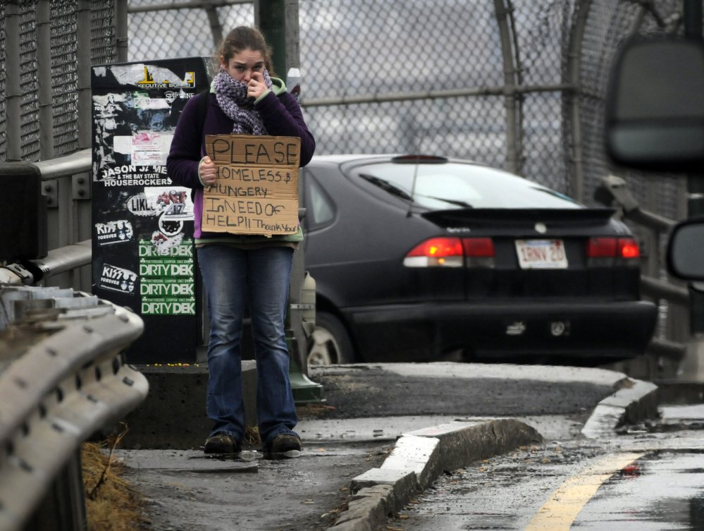 Panhandlers like this one face a $50 fine or community service if they ask for money while standing on a traffic island or within 20 feet of bus stops, restaurants with outdoor seating, ATMs, and a few other select locations in Worcester, Mass.