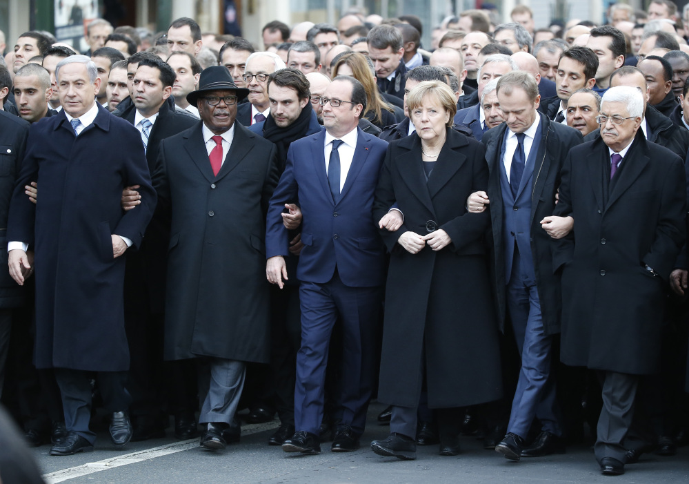 Front from the left, Israeli Prime Minister Benjamin Netanyahu, Malian President Ibrahim Boubacar Keita, French President Francois Hollande, German Chancellor Angela Merkel, EU Council President Donald Tusk and Palestinian Authority President Mahmoud Abbas, process arm-in-arm in Paris on Sunday.
