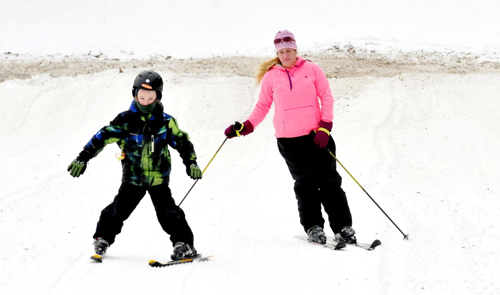 Bradie Castonguay of Waterville and her son, Ethan, enjoy Eaton Mountain Ski Area in Skowhegan, where a new rope tow has allowed ski trails to reopen.
