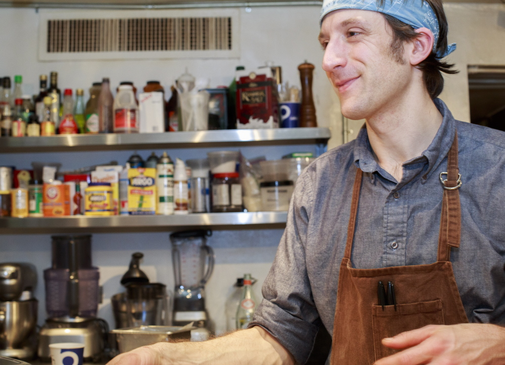 In this file photo Chef David Levi is all smiles working in the kitchen at the James Beard House in Manhattan in January.