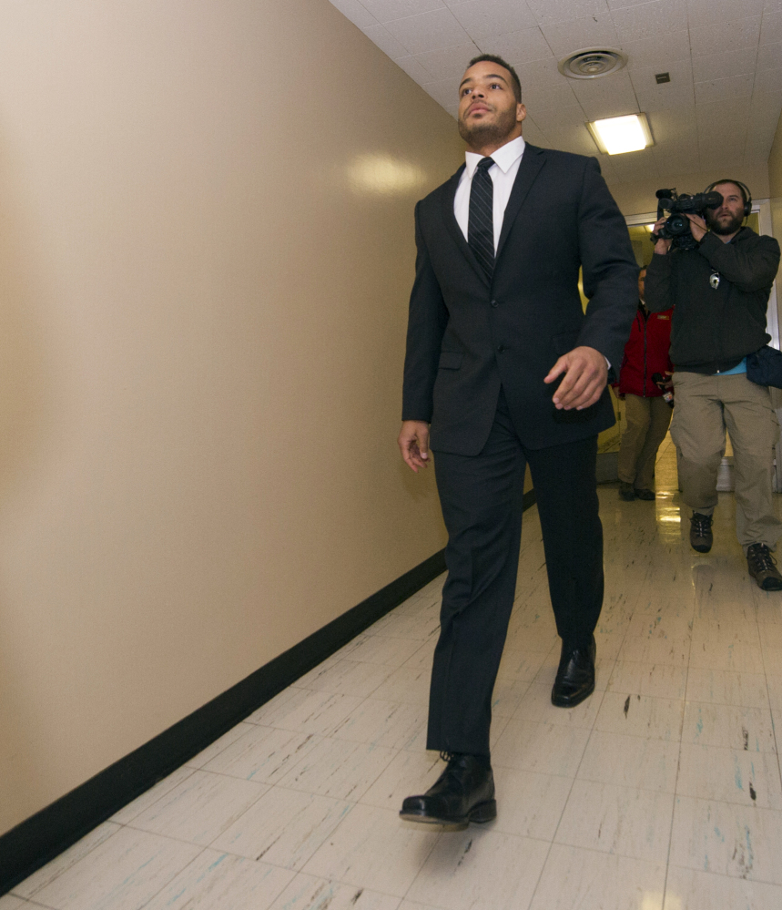The Indianapolis Colts' Joshua McNary walks to his initial appearance in Marion County Superior Court in Indianapolis on Thursday. The Colts put McNary on the commissioner's exempt list Thursday, less than 24 hours after prosecutors charged the backup linebacker with rape, criminal confinement with bodily injury and battery resulting in bodily injury. McNary denied the allegations.