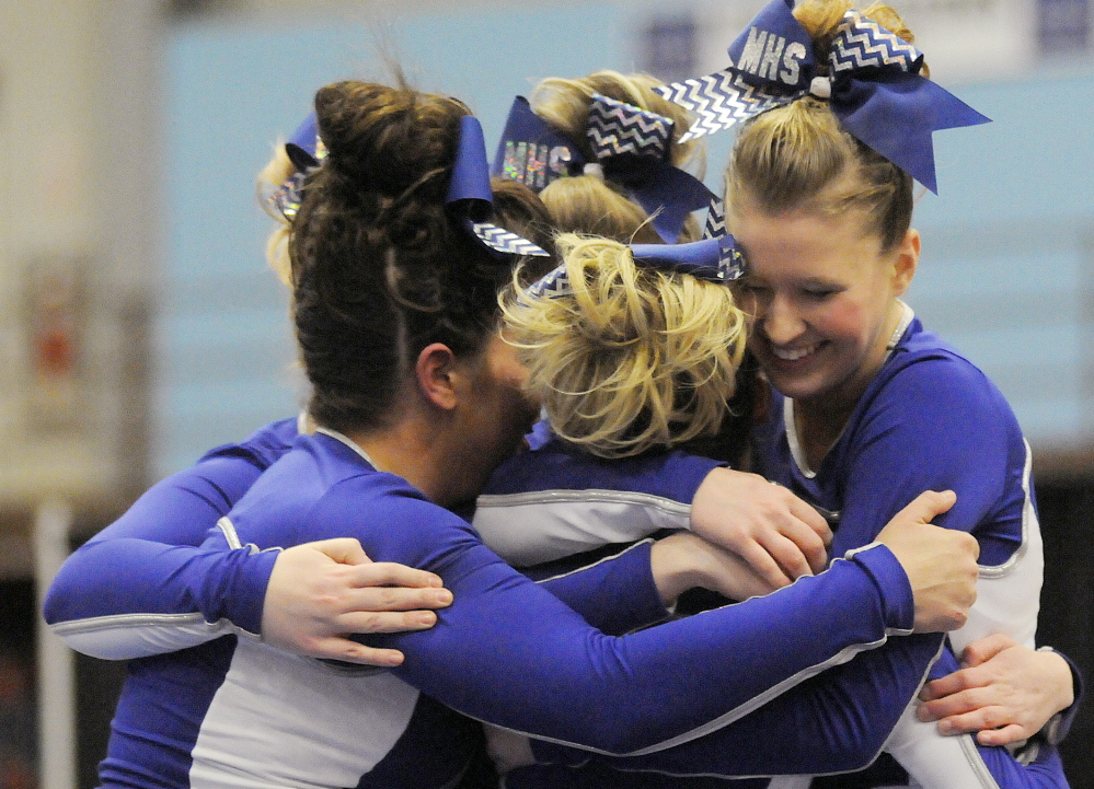 Members of the Madison cheerleading team celebrate Monday after competing in the Western C championships. The Bulldogs finished runner-up to Dirigo. Andy Molloy /Kennebec Journal