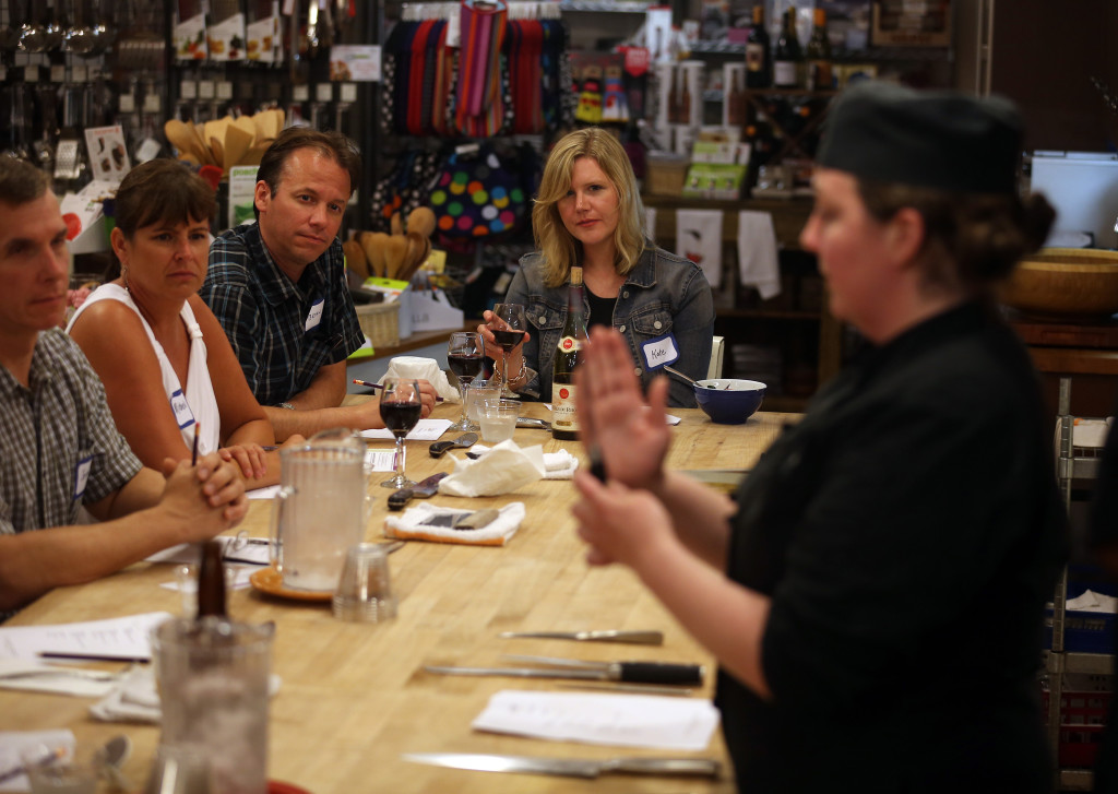 Cooking schools have evolved to empower us to cook. Chef instructor Michele Glancey at the Chopping Block in Chicago demonstrates knife skills.