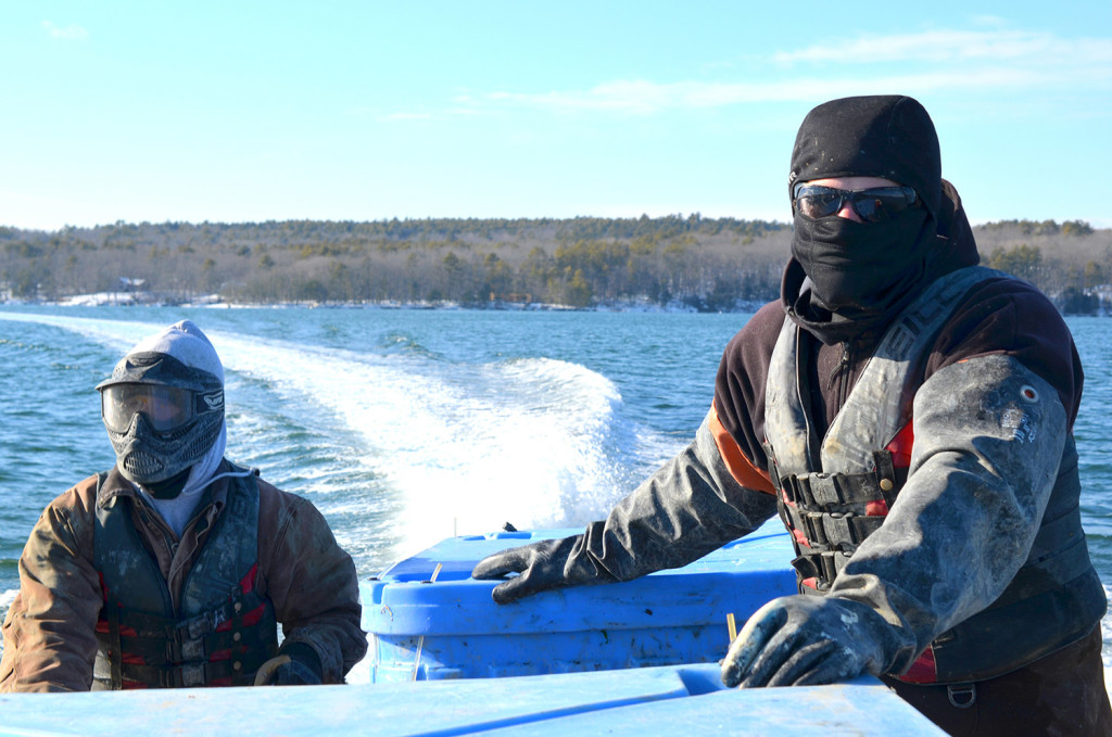 Nate Jones and Jeff Auger, employees of Mook Sea Farm, are bundled against the cold as they barrel down the Damariscotta River to harvest oysters this month.