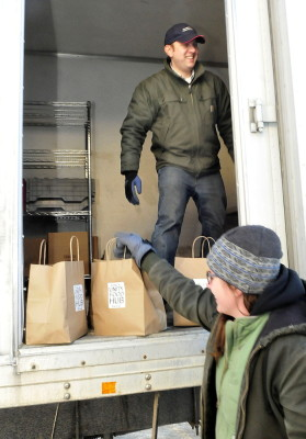 Matt Tremblay, manager of the Unity Food Hub, unloads food with help from Colleen Hanlon-Smith at Johnny's Selected Seeds in Fairfield. David Leaming/Morning Sentinel