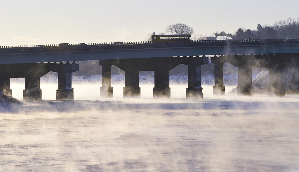 Drivers head into the Portland area over Tukey's Bridge as sea smoke rises from the Back Cove.  Gordon Chibroski/Staff Photographer