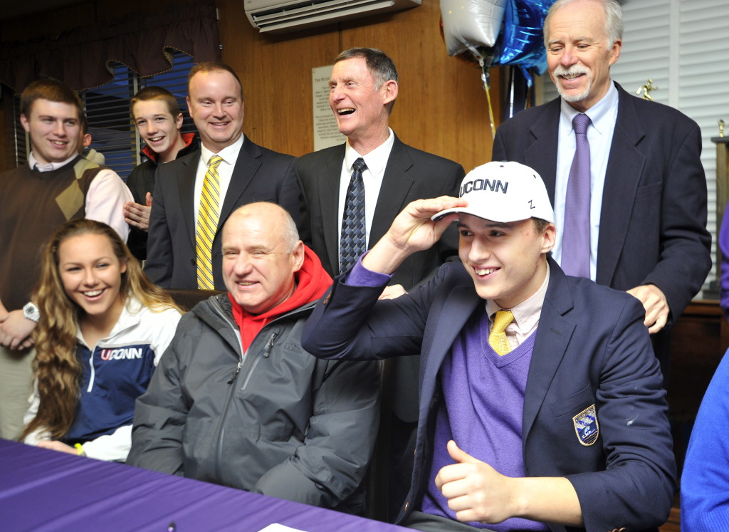 """Zordan Holman dons a UConn cap after signing a letter of intent to play for the Huskies. Holman is projected to be a tight end at Connecticut. """"I'll play wherever they need me,"""" said Holman. Gordon Chibroski/Staff Photographer"""