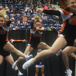 Biddeford high school cheerleaders perform their routine during the Maine State Cheerleading Championships at the Augusta Civic Center. Whitney Hayward/Staff Photographer