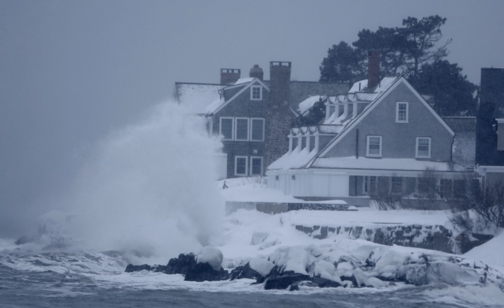 A wave crashes against rocks in front of a seaside home in Kennebunk. The storm kicked up some big surf but coastal flooding was minor in Kennebunk on Sunday morning. Gregory Rec/Staff Photographer