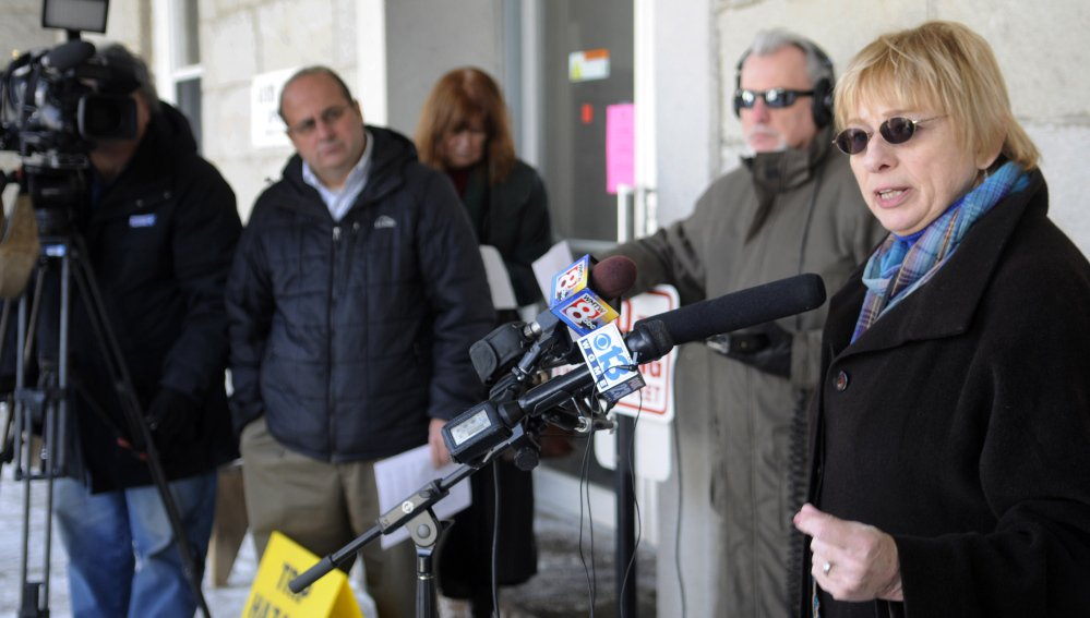 Maine Attorney General Janet Mills announces a settlement Wednesday in Augusta between the federal Department of Justice and Standard & Poor's financial services.
