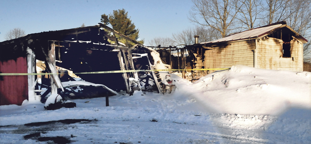 The mobile home and a garage owned by Joyce Bragg were destroyed by fire Thursday. Two cats died in the fire at the home at 28 Albion Road in China.