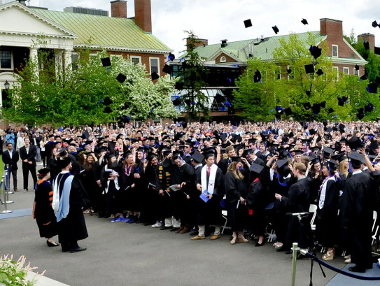 Staff file photo by David Leaming The Colby College graduating class of 2014 signals the end of their commencement by tossing their mortarboard caps into the air. The college has had a 47 percent hike in applications this year.