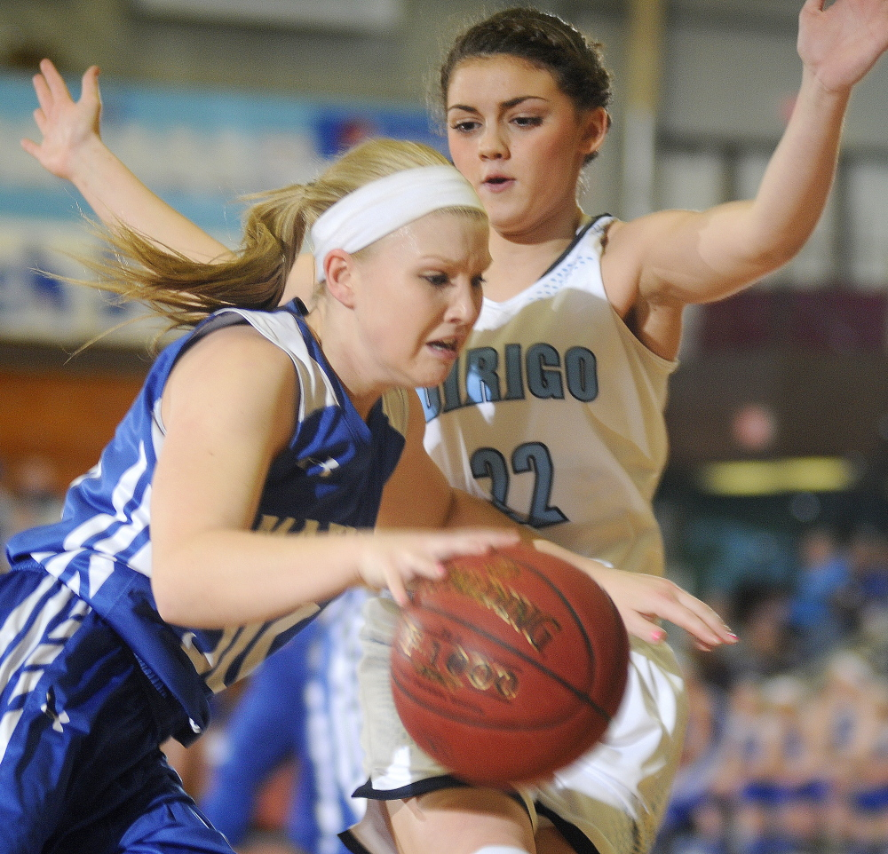 Madison's Madeline Wood dribbles around Dirigo High School's Olivia Noyes during a Western C semifinal Friday afternoon at the Augusta Civic Center.