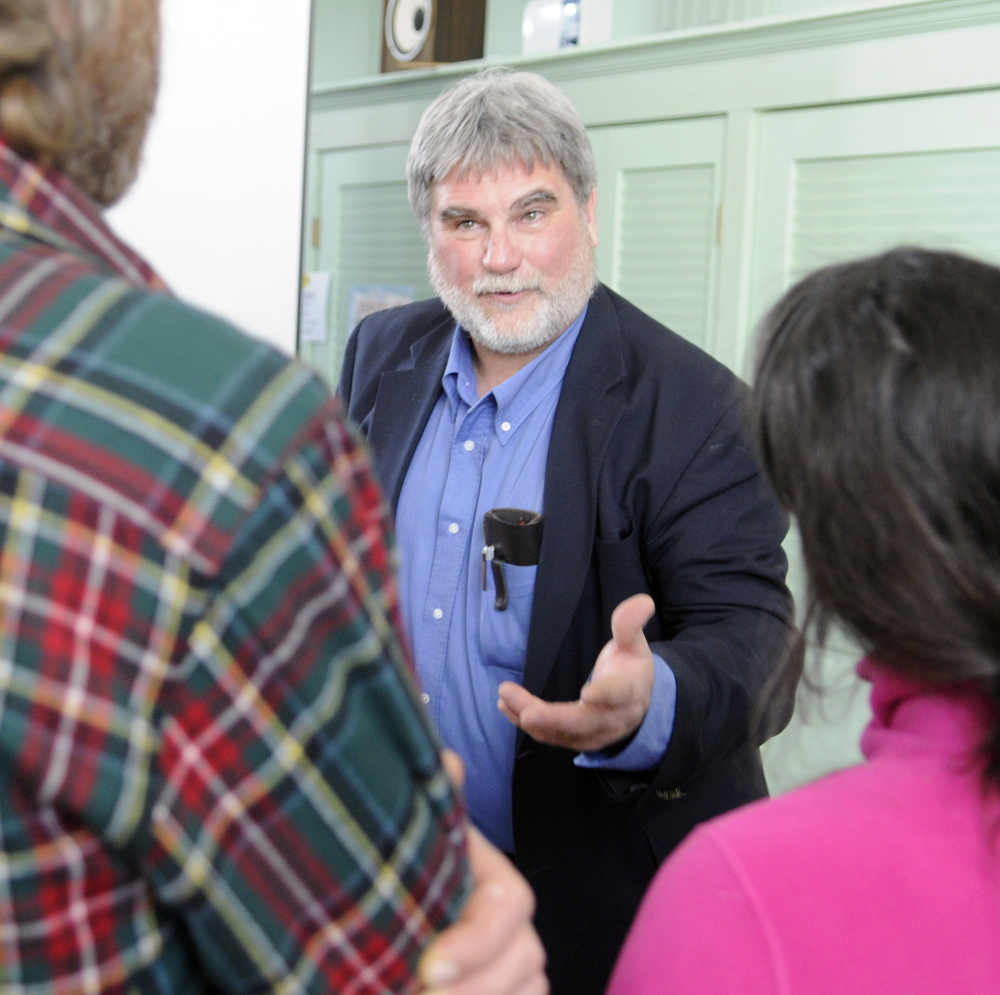 Arthur Spiess, an archeologist with the Maine Historic Preservation Commission, answers a question about the Dresden Falls Archaic Site after a meeting of the Dresden Historical Society on Sunday at Bridge Academy Public Library in Dresden.