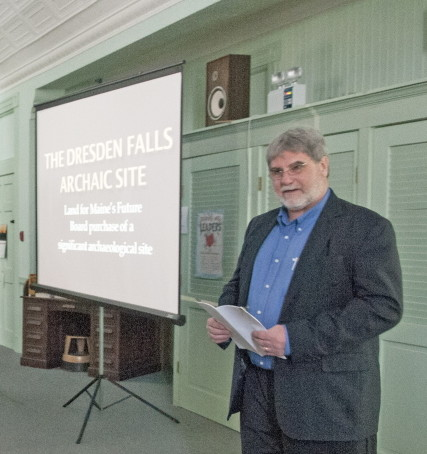 Arthur Spiess, an archeologist with the Maine Historic Preservation Commission, talks about the Dresden Falls Archaic Site during a meeting of the Dresden Historical Society at Bridge Academy Public Library in Dresden on Sunday.