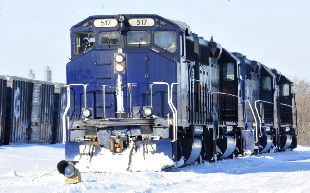 Two Pan Am Railways engines idle Monday at the Waterville yard, where the U.S. EPA says the company is facing $375,000 in civil penalties for violating federal and state environmental regulations.