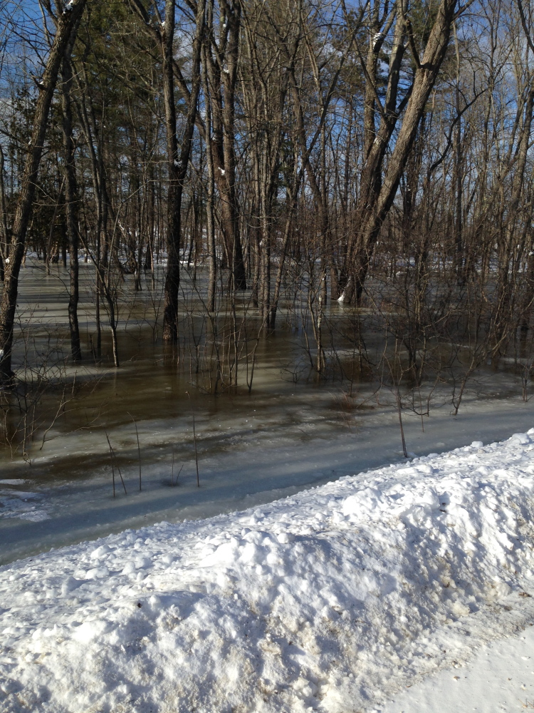 Flooding attributed to an ice jam on the Kennebec River, near its confluence with the Carrabassett River, is seen in this Jan. 28 photo. Experts are worried that ice jams and a rapid melting of this winter's significant snowpack could result in flooding in the spring.