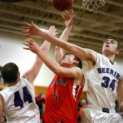 FEB. 10 PRELIM: Raffaele Salamone, left, and Jacob Coon of Deering combine to block a shot by Scarborough's Reece Langerquist during the first quarter of their preliminary round playoff game. Deering won a 78-62 contest to move into the Class A quarterfinal round.