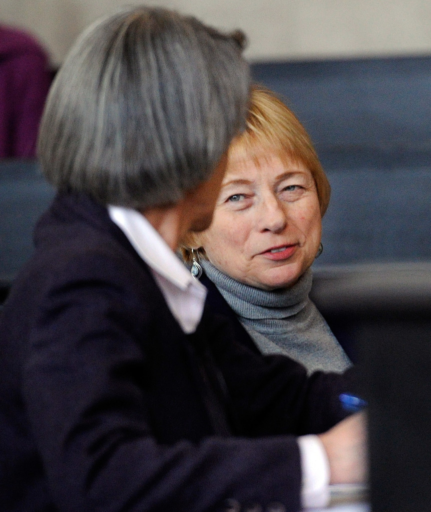 Attorney General Janet Mills talks with attorney Phyllis Gardiner at the Maine Supreme Judicial Court on Thursday.