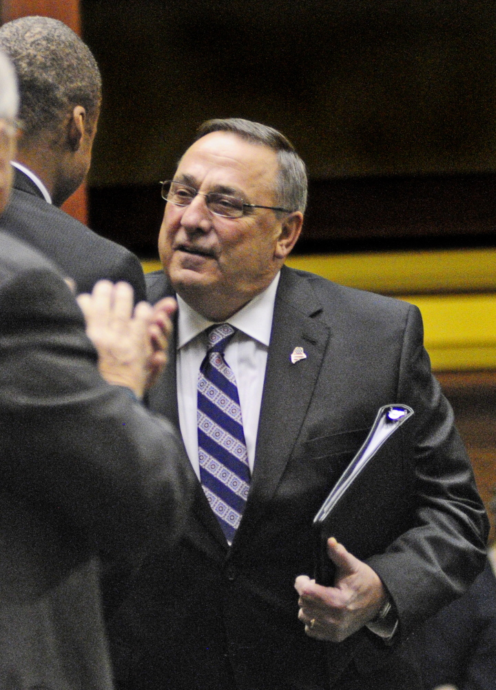 Rep. Craig Hickman, D-Winthrop, greets Gov. Paul LePage as he enters the State House before his speech to a joint legislative session.