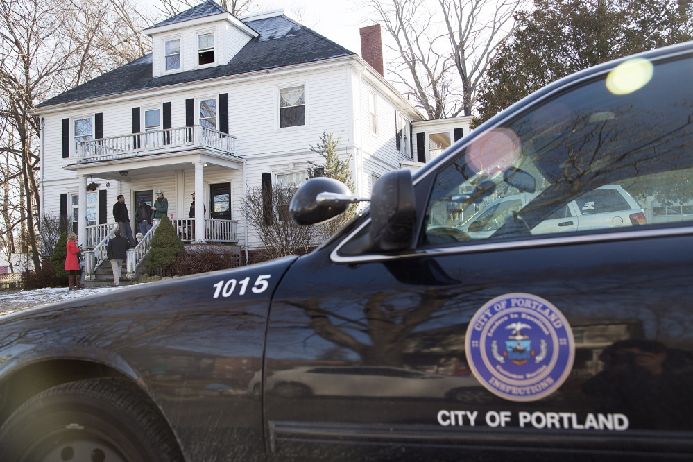 A city of Portland inspectors' vehicle is parked outside 186-188 Dartmouth St. Code violations were found during a Jan. 20 inspection.