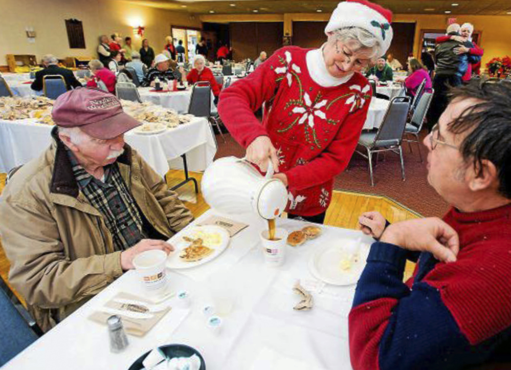 Connie Howe pours coffee for Ronald Read, left, and Dave Smith during a holiday breakfast in December 2011 at the American Legion in Brattleboro, Vt. Before Read bequeathed $6 million to the town's hospital and library, no one knew he was wealthy.