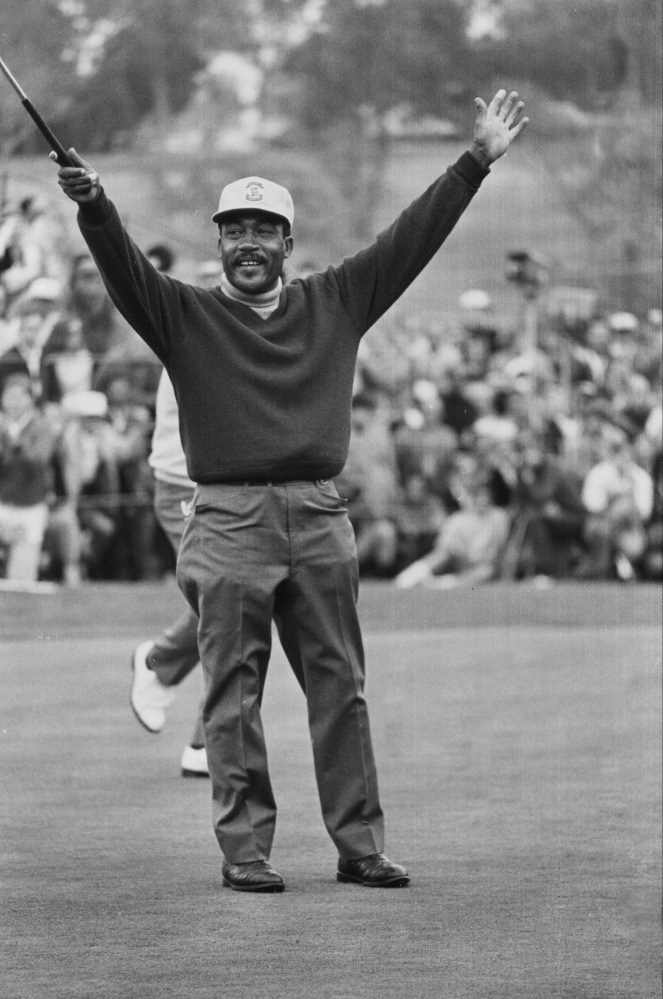Charlie Sifford throws up his arms after sinking a short par putt on the 18th green to tie Harold Henning at the end of 72 holes in the 1969 Los Angeles Open. Sifford, who fought the Caucasian-only clause on the PGA Tour and became its first black member died, Tuesday at the age of 92.