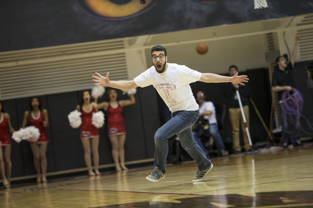 "Dan Ray celebrates after sinking a half-court shot worth $10,000 in a promotion at a Temple basketball game. ""It was a rush of adrenaline I've never felt before,"" Ray said."