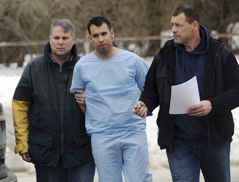 Officials lead Adrian Loya into District Court Thursday, in Falmouth, Mass., where he was arraigned on charges he killed a woman, injured another and shot a police officer.