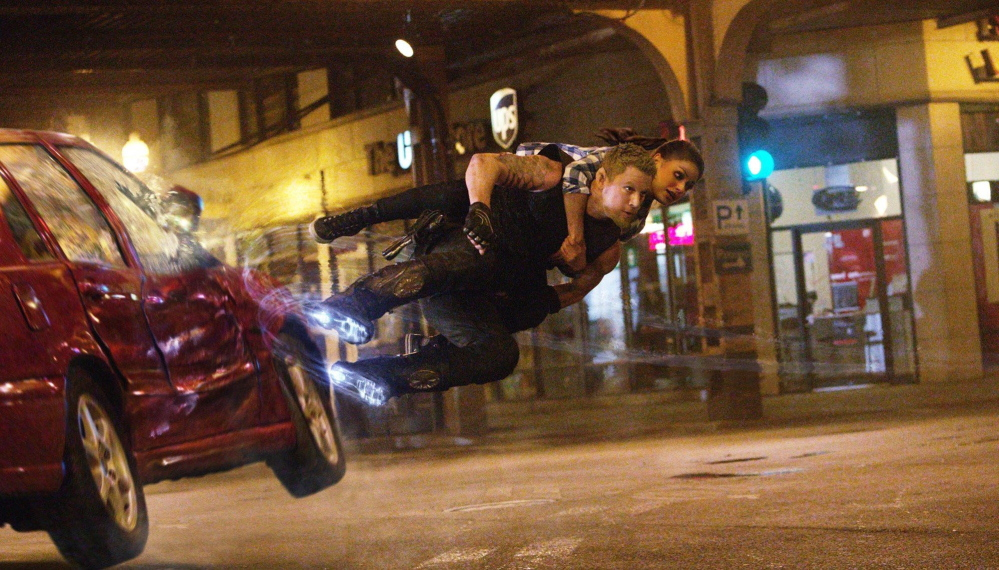 "Channing Tatum as Caine and Mila Kunis as Jupiter in ""Jupiter Ascending."""