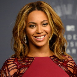 Beyoncé is up for Grammys for album, record and song of the year. Associated Press