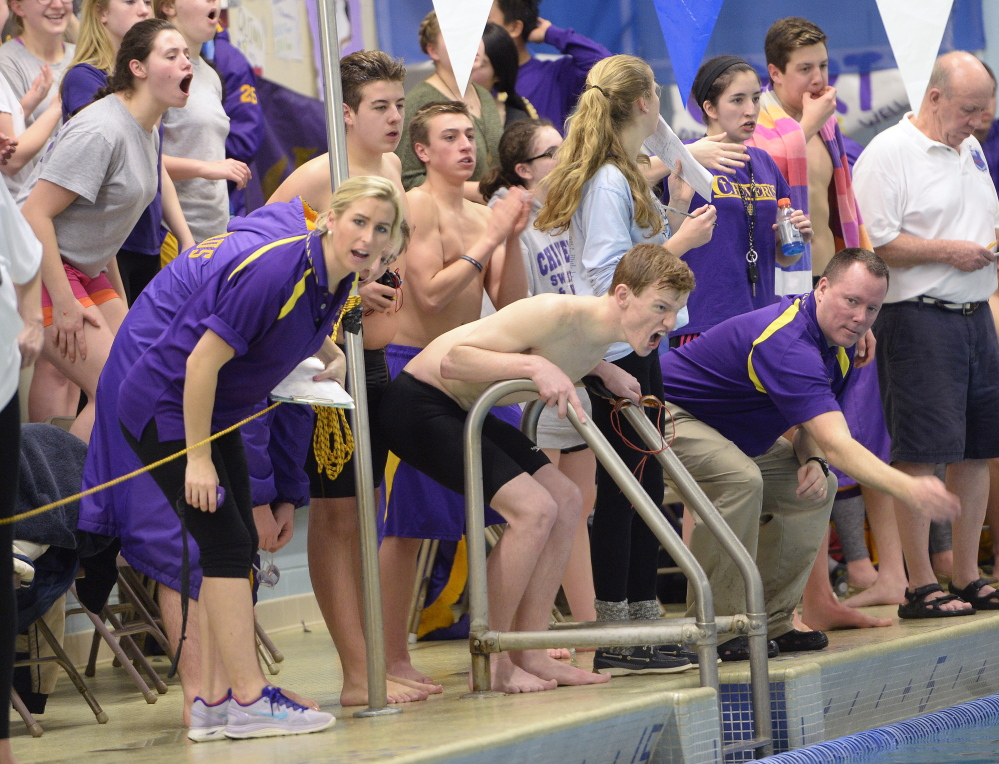 Cheverus Coach Kevin Haley, right, and his swimmers cheer on their teammates at the boys' North Southwesterns in Westbrook on Feb. 6. The Stags earned their third consecutive league championship with 335 points, far ahead of runner-up Cape Elizabeth (221).
