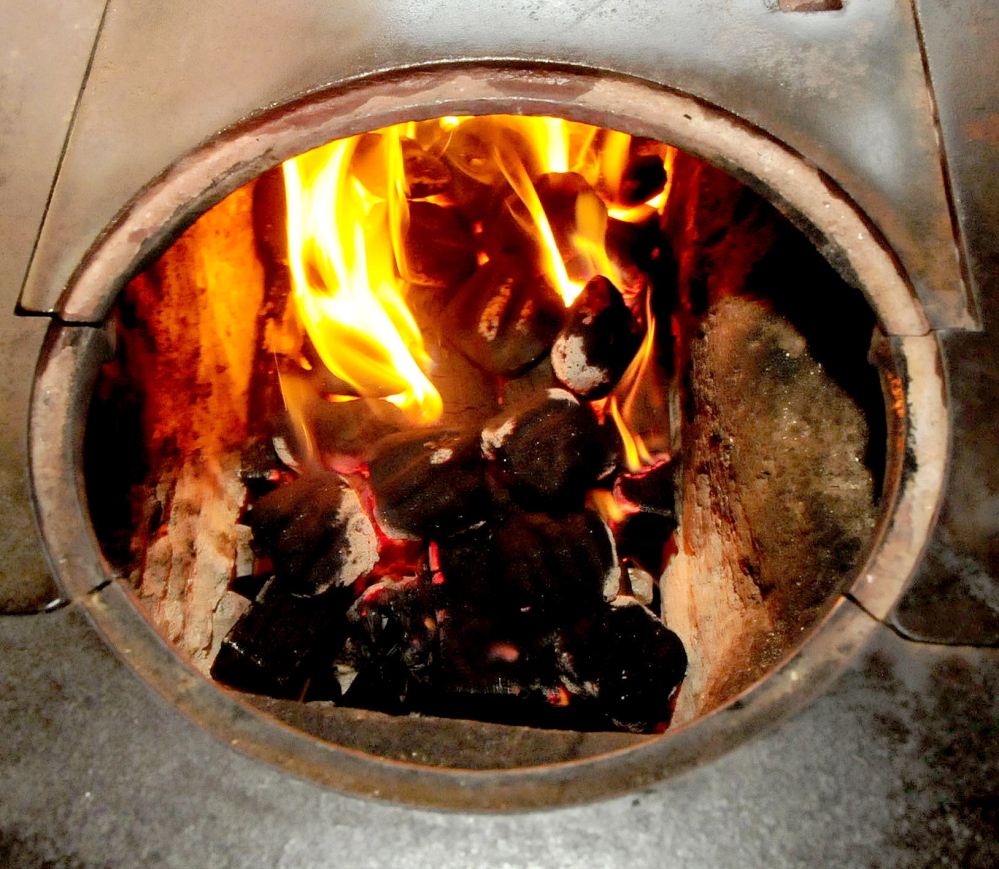 Nut coal begins to catch inside a coal burning stove a the home of John and Ruth Keister in Norridgewock. The Keisters say they enjoy burning coal that is economical, efficient and puts out a lot of heat.