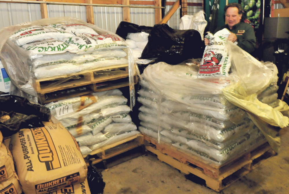 Aubuchon Hardware store manager Mario Bisol pulls out a bag of one of the varieties of coal sold at the Skowhegan store. The company sells different size coal products including blacksmith, rice, nut and pea coals.