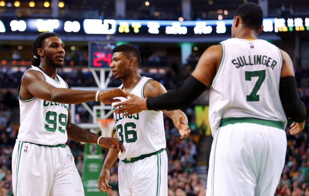 Boston's Jared Sullinger, right, is congratulated by Jae Crowder (99) and Marcus Smart after making a basket during the second half of the Celtics' 107-96 win over the Philadelphia 76ers Friday night in Boston. Sullinger finished with a team-high 22 points.