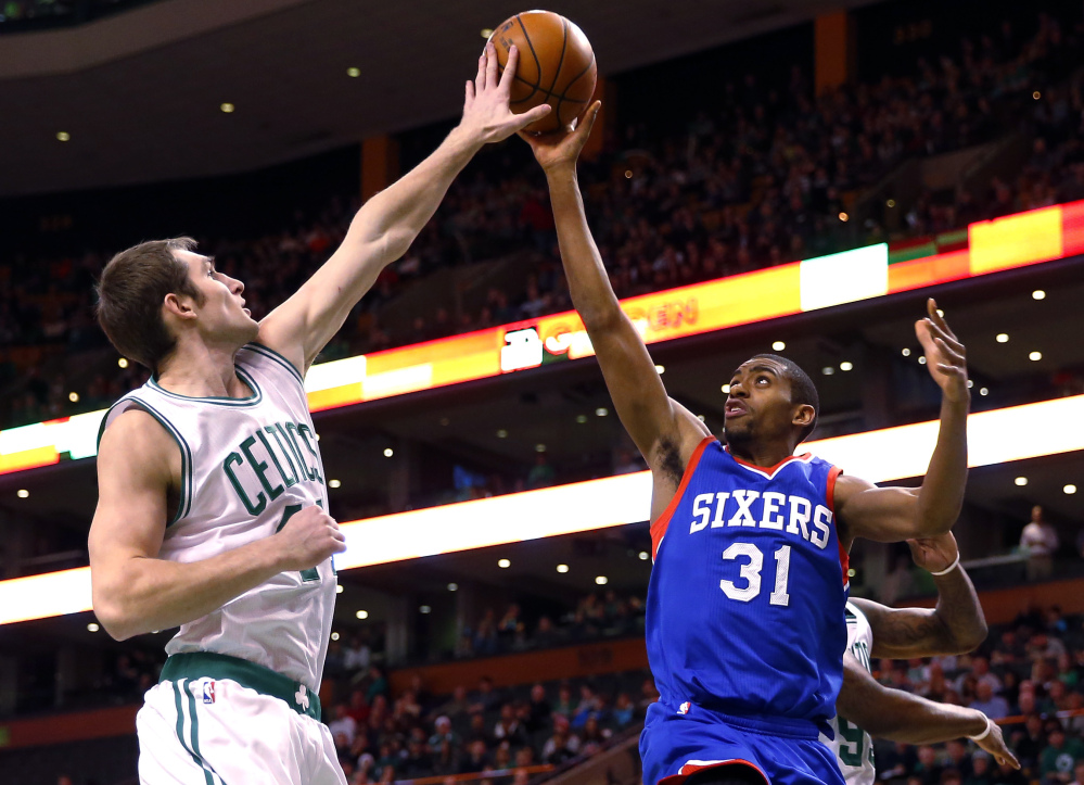 Philadelphia's Hollis Thompson has his shot blocked by Boston's Tyler Zeller during the first quarter of Friday night's game in Boston
