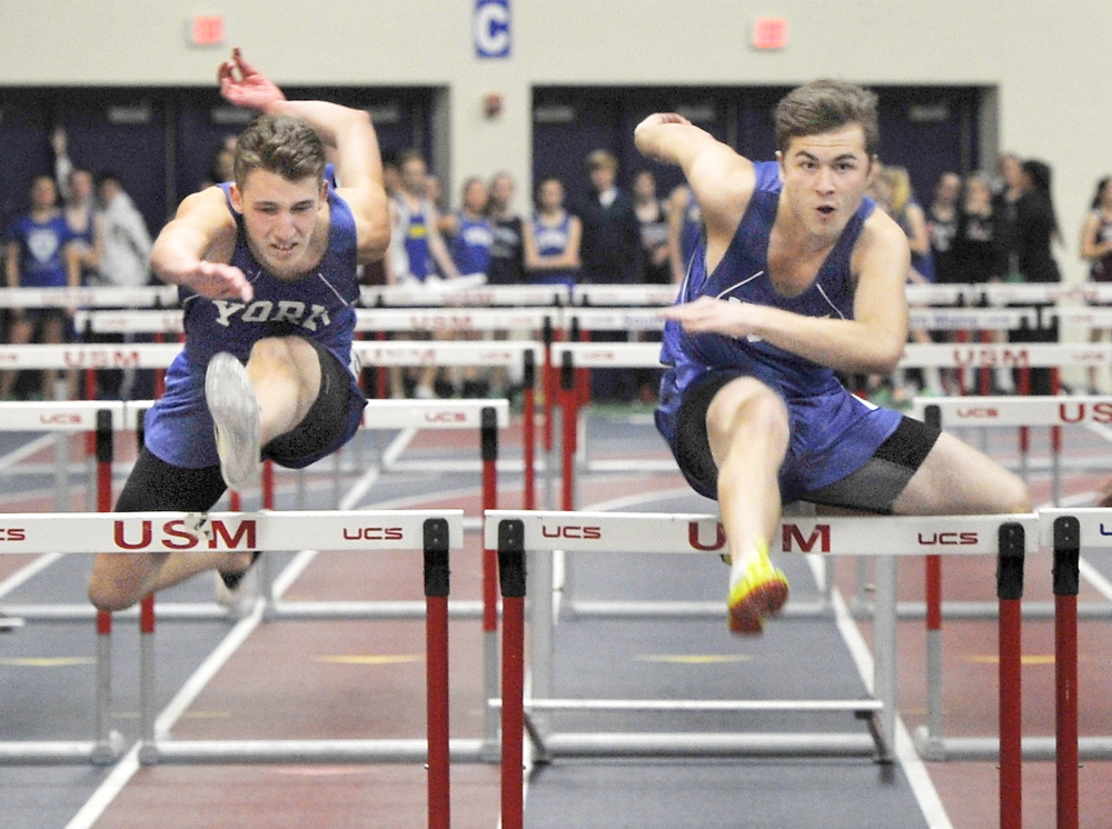 York's Colt Santoro, right, edges teammate Matt Arsenault to win the 55-meter hurdles at the Western Maine Conference indoor track and field championships in Gorham on Friday. Santoro finished in 8.31 seconds.