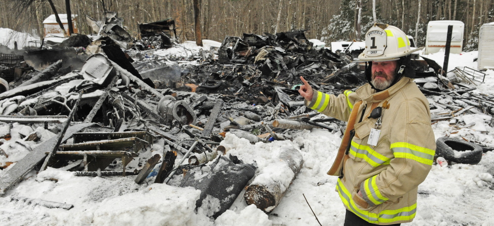 Whitefield Fire Chief Scott Higgins answers questions during an interview on Jan. 28 at 452 Mills Road in Whitefield, the scene of one of the recent fires that have kept area firefighters busy.
