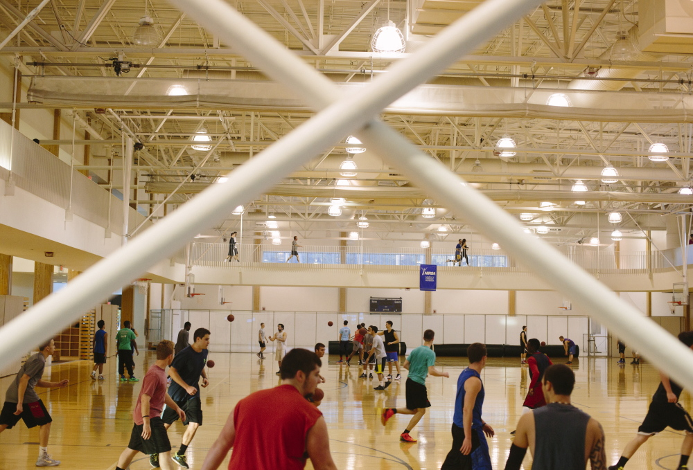 The $25 million New Balance Student Recreation Center at the University of Maine in Orono has, among other amenities, eight basketball courts and a second-story running track. Investing in such facilities can play a role in attracting students, top faculty and administrators.