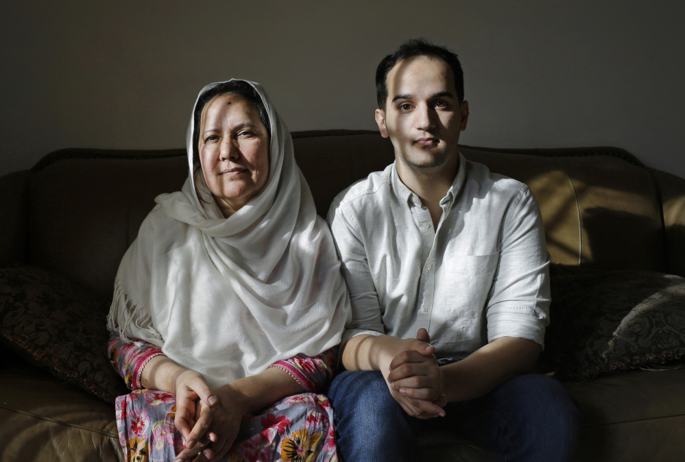 """Shamim Syed, left, whose son Adnan was convicted in the 1999 murder of his ex-girlfriend, is shown alongside son Yusef at her Baltimore home. Adnan, the subject of popular podcast """"Serial,"""" will be allowed to appeal his murder conviction, a Maryland court has ruled."""