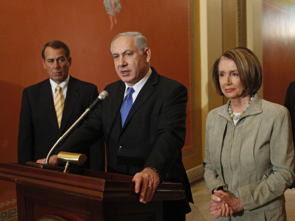 In this March 23, 2010 file photo, Israeli Prime Minister Benjamin Netanyahu, center, flanked by then-House Minority Leader John Boehner of Ohio and then-House Speaker Nancy Pelosi of Calif., speaks to the media on Capitol Hill in Washington.