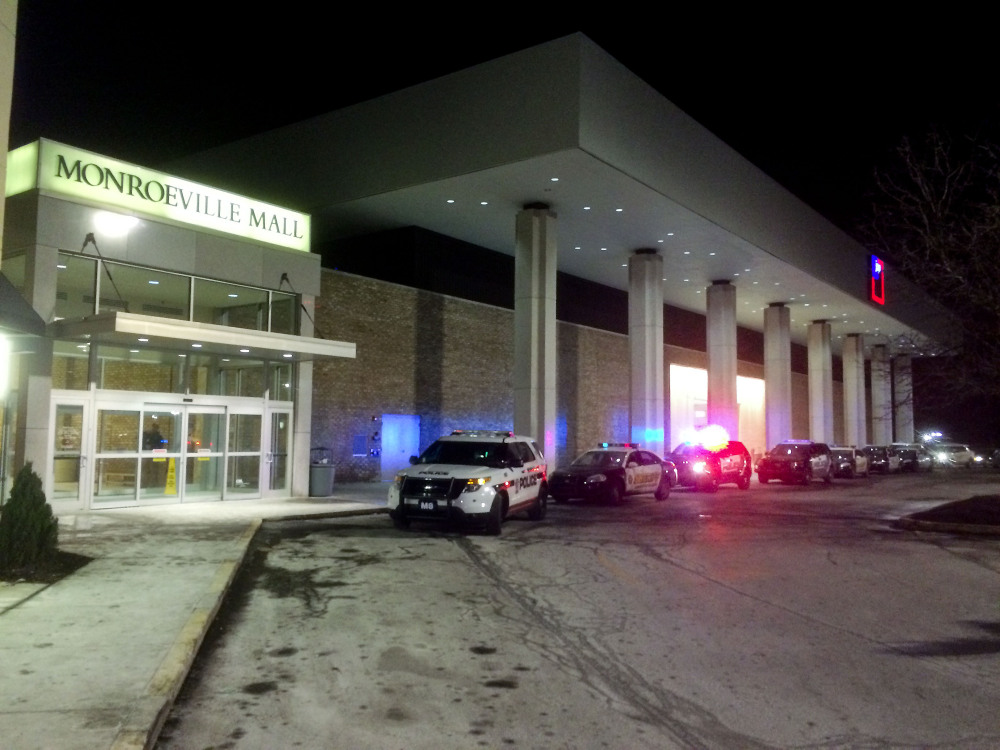 Police vehicles line up outside Monroeville Mall on Saturday after a shooting took place inside. As many as three people were injured.